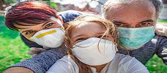 Selfie of Family Wearing Face Masks
