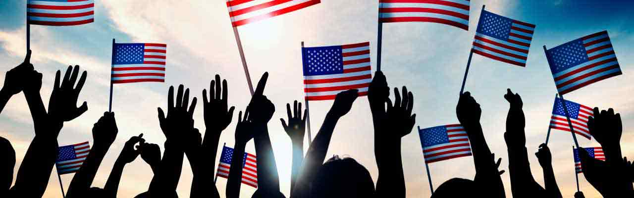 Raised Hands Holding US Flags