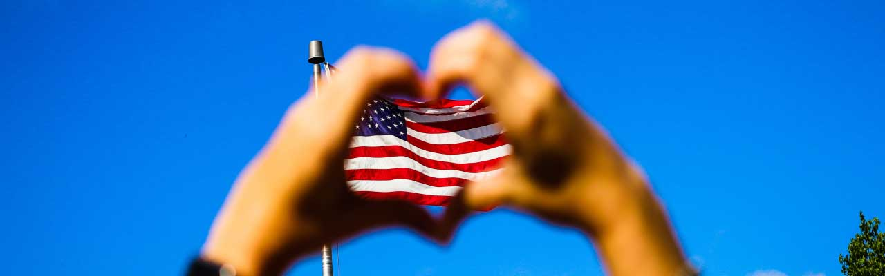 Two Hands Shaping Heart Encircling US Flag